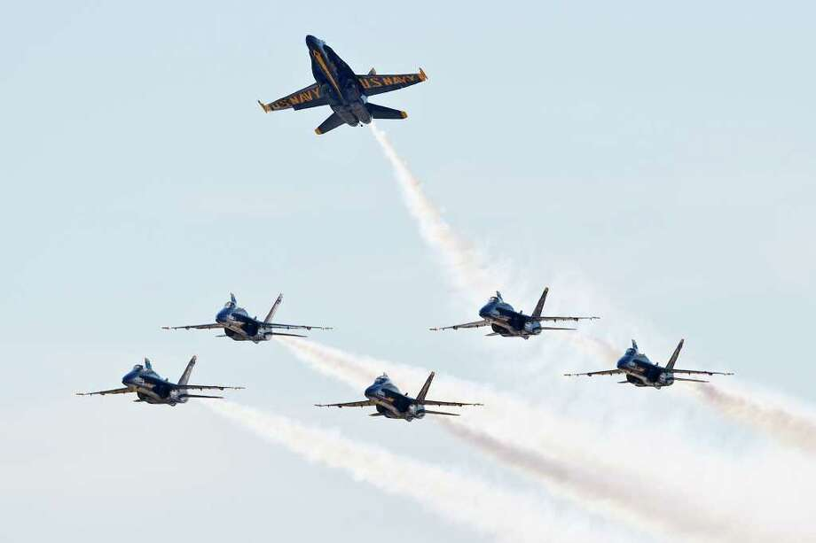 """The U.S. Navy Blue Angels begin their """"Delta Pitch to Land"""" manuver at the end of their performance during the 2011 Randolph AFB Air Show on Oct. 29, 2011.  Photo by Marvin Pfeiffer Photo: MARVIN PFEIFFER, Marvin Pfeiffer/Prime Time Newspapers / Prime Time Newspapers 2011"""