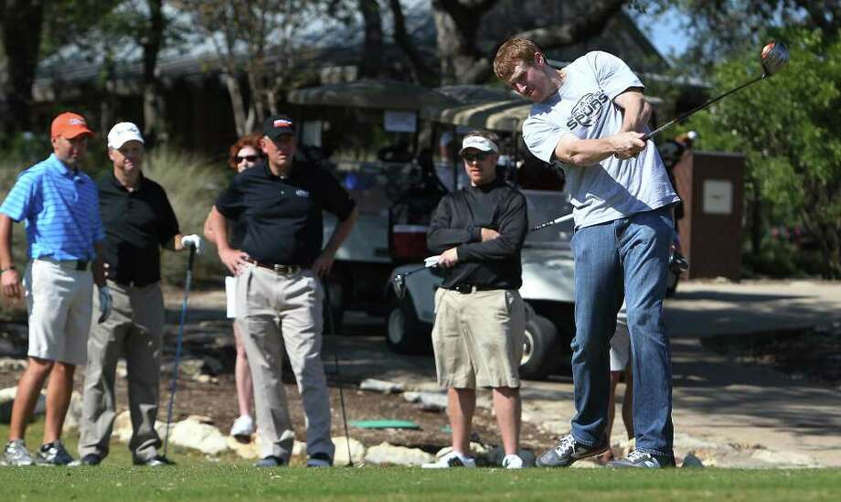 Spurs forward Matt Bonner (right) drives a ball on the No. 1 tee box as he hosts the 2011 Matt Bonner Charity Golf Tournament for Kids Sports Network at Canyon Springs Golf Club on Tuesday, Nov. 1, 2011. Bonner, who is also the vice president of the NBA Players Association and on break from the contentious negotiations, took time to meet with golfers who donated to the 13th annual charity tournament which benefits youth athletics. Photo: Kin Man Hui, SAN ANTONIO EXPRESS-NEWS / San Antonio Express-News