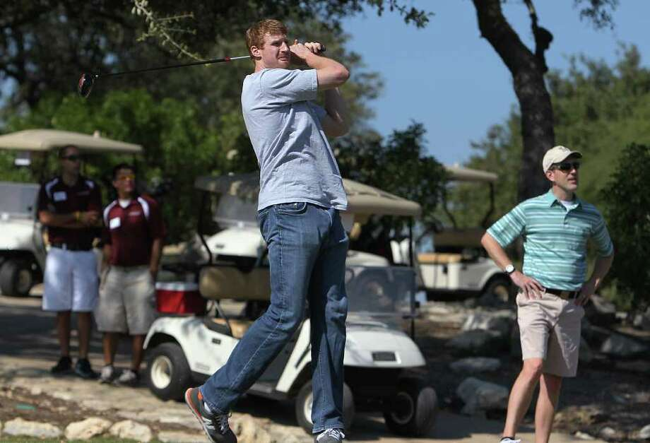 Spurs forward Matt Bonner (center) tracks his tee shot from the No. 1 tee box as he hosts the 2011 Matt Bonner Charity Golf Tournament for Kids Sports Network at Canyon Springs Golf Club on Tuesday, Nov. 1, 2011. Bonner, who is also the vice president of the NBA Players Association and on break from the contentious negotiations, took time to meet with golfers who donated to the 13th annual charity tournament which benefits youth athletics. Photo: Kin Man Hui, SAN ANTONIO EXPRESS-NEWS / San Antonio Express-News