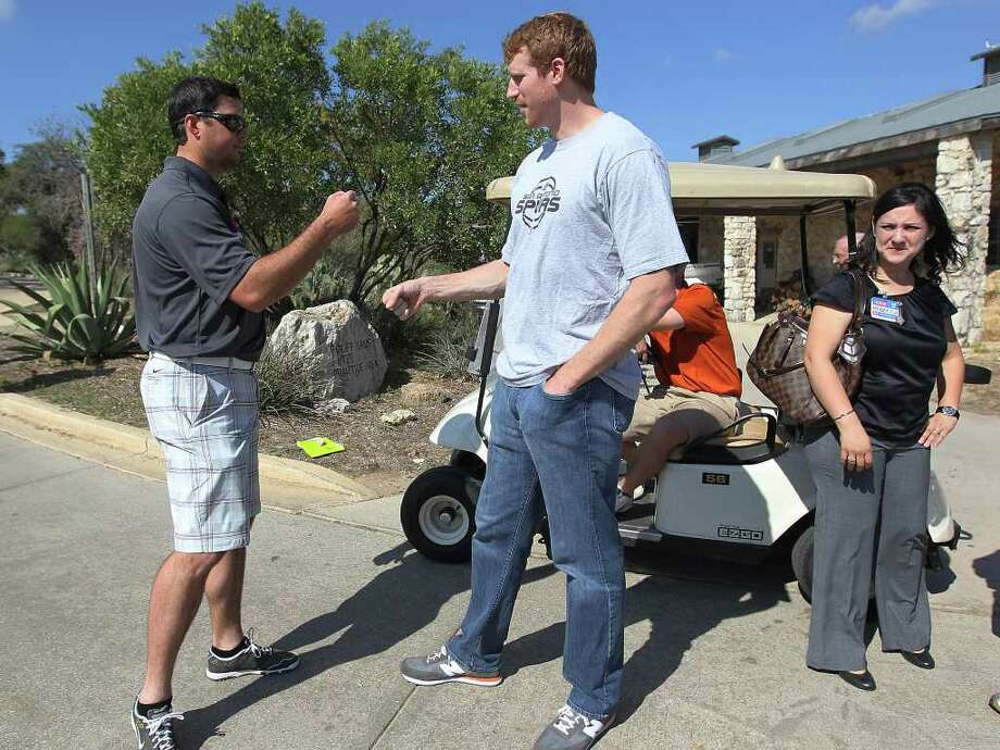Spurs forward Matt Bonner (center) and Boston Red Sox pitcher Josh Beckett (left) wish one another well on the golf course as Bonner hosts the 2011 Matt Bonner Charity Golf Tournament for Kids Sports Network at Canyon Springs Golf Club on Tuesday, Nov. 1, 2011. Bonner, who is also the vice president of the NBA Players Association and on break from the contentious negotiations, took time to meet with golfers who donated to the 13th annual charity tournament which benefits youth athletics. Photo: Kin Man Hui, SAN ANTONIO EXPRESS-NEWS / San Antonio Express-News