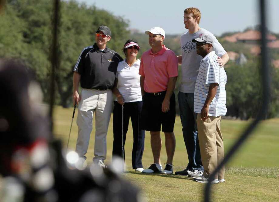 Spurs forward Matt Bonner (second from right) poses for a photo with golfers at the 2011 Matt Bonner Charity Golf Tournament for Kids Sports Network at Canyon Springs Golf Club on Tuesday, Nov. 1, 2011. Bonner, who is also the vice president of the NBA Players Association and on break from the contentious negotiations, took time to meet with the golfers who donated to the 13th annual charity tournament which benefits youth athletics. Photo: Kin Man Hui, SAN ANTONIO EXPRESS-NEWS / San Antonio Express-News