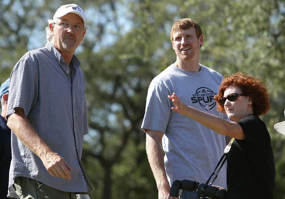 Spurs forward Matt Bonner (second from right) and former Spur Coby Dietrick (left) take directions from a tournament photographer as Bonner hosts the 2011 Matt Bonner Charity Golf Tournament for Kids Sports Network at Canyon Springs Golf Club on Tuesday, Nov. 1, 2011. Bonner, who is also the vice president of the NBA Players Association and on break from the contentious negotiations, took time to meet with golfers who donated to the 13th annual charity tournament which benefits youth athletics. Photo: Kin Man Hui, SAN ANTONIO EXPRESS-NEWS / San Antonio Express-News