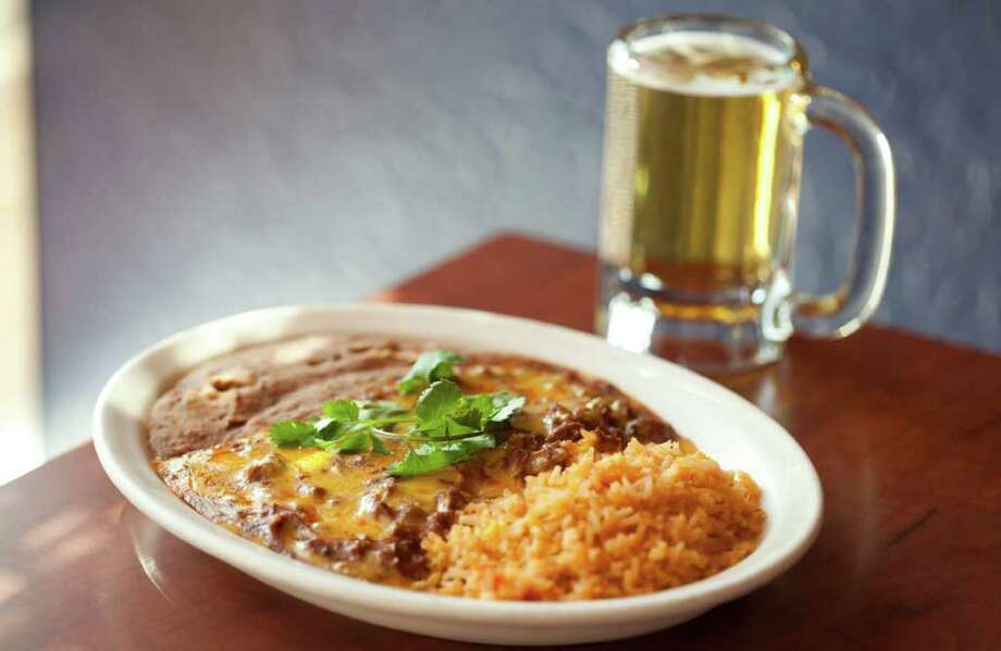 Cheese enchilada with chili con carne plate at Molina's Cantina, Houston Photo: Julie Soefer