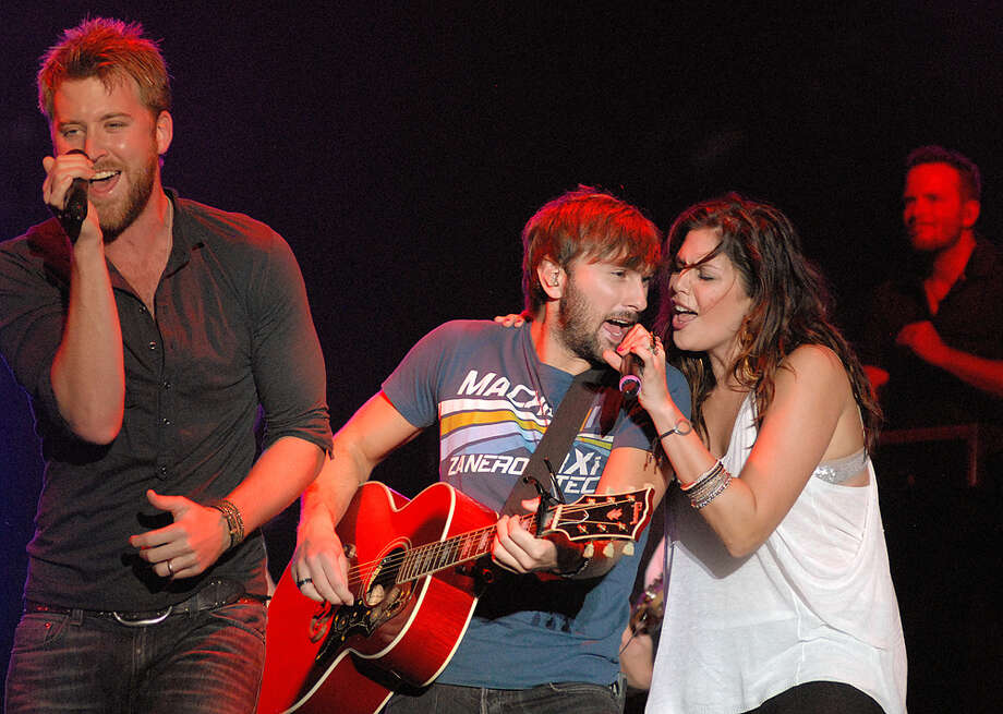 """Lady Antebellum, Feb. 17, 7:30 p.m.Country pop trio's drunk-dialing anthem """"Need You Now"""" blew up in 2010, making the album of the same name one of the year's best selling CDs. The follow-up, last year's """"Own the Night,"""" was a hit, too, debuting at No. 1 and producing the hit singles """"Just a Kiss"""" and """"We Owned the Night."""" The group — Charles Kelley, Hillary Scott and Dave Haywood — is up for best country album at this year's Grammys. ATHONY WEBER / TROY DAILY NEWS / AP"""