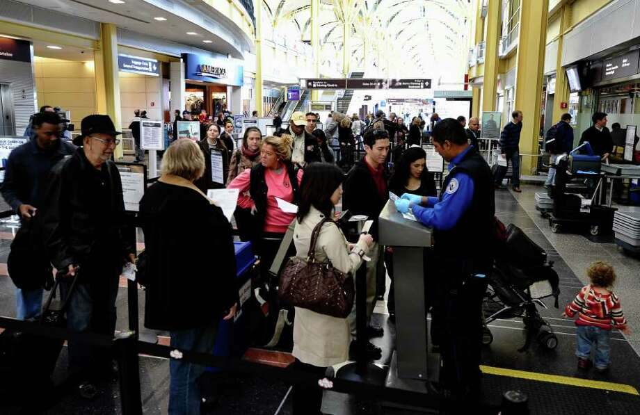 Travellers go through a Transportation Security Administration checkpoint at Reagan National Airport in Washington, D.C., on Nov. 24, 2010. Photo: JEWEL SAMAD, AFP/Getty Images / 2010 AFP