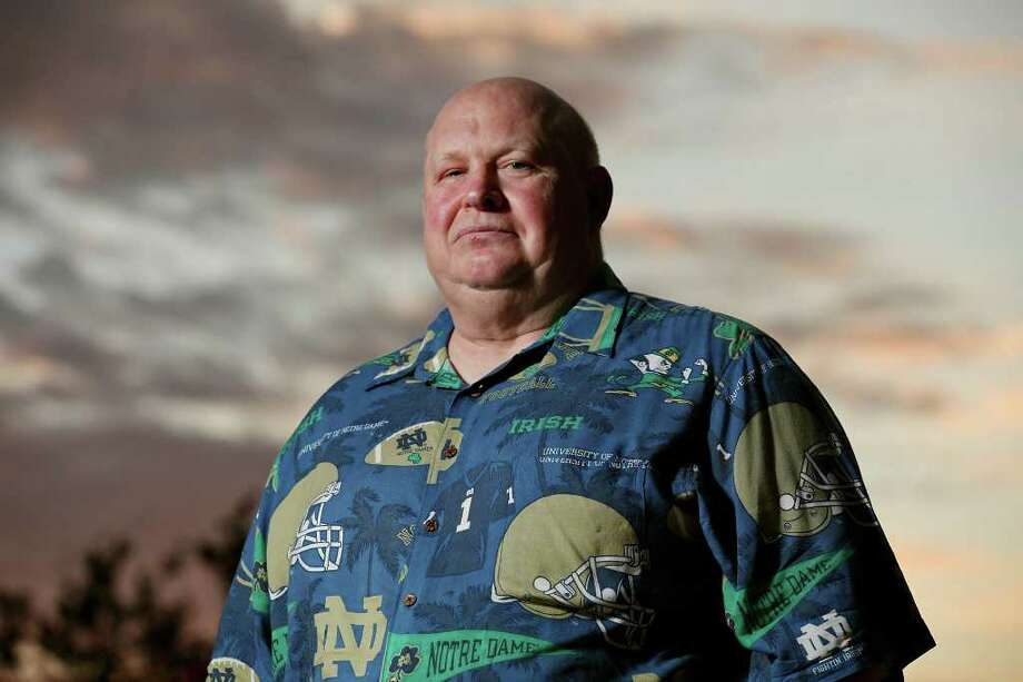 Nils Rockne, the grandson of legendary Notre Dame coach Knute Rockne, quite literally wears his love for the Irish football program on his sleeve. Photo: EDWARD A. ORNELAS, SAN ANTONIO EXPRESS-NEWS / © SAN ANTONIO EXPRESS-NEWS (NFS)