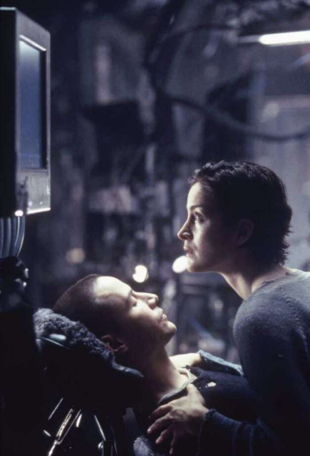 THE MATRIX starring Keanu Reeves and Carrie-Anne Moss    --  1999 Photo: Jasin Boland / handout slide