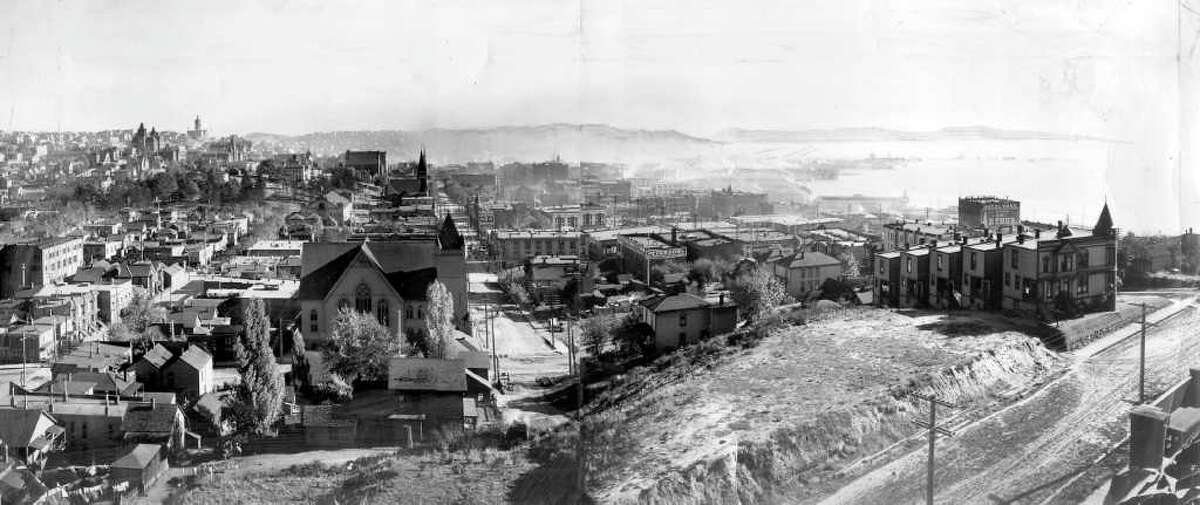 This is what the view looked like from Denny Hill in 1903, looking south. The intersection in the immediate foreground is Third Avenue and Pine Street.