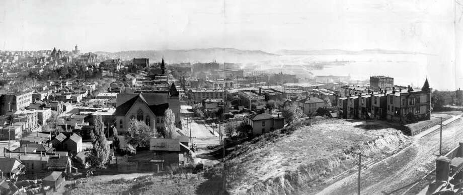 This is what the view looked like from Denny Hill in 1903. This view of the city is looking south from the hill that was later leveled. The intersection in the immedate foreground is Third Avenue and Pine Street. Photo: Seattlepi.com File/1903