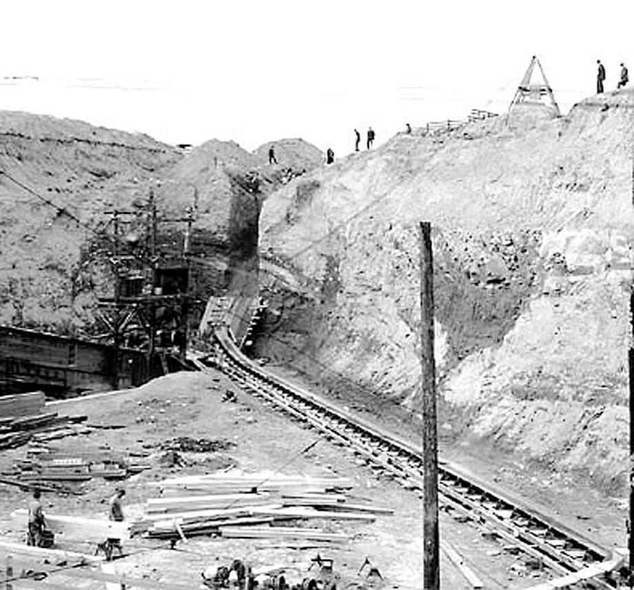"""The Seattle Post-Intelligencer referred to the Denny regrade as """"one of the great engineering projects of the West."""" Steam shovels and water sluices ate away at the hillside and conveyor belts carried the dirt to Elliott Bay. Photo: Seattlepi.com File / Seattle Post-Intelligencer"""