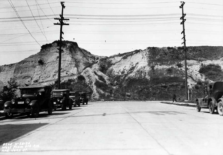 Looking west at Denny Hill from Ninth Avenue and John Street, April 25, 1930. Photo: Seattle Municipal Archives