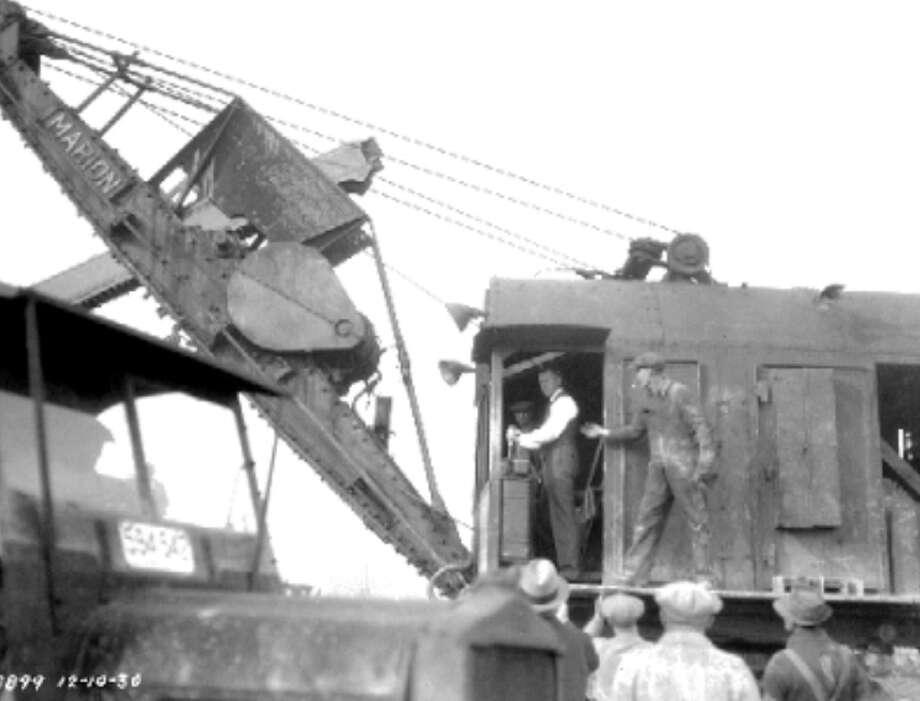 The last shovel at a Denny regrade finishing ceremony, Dec 10, 1930. Photo: Seattle Municipal Archives