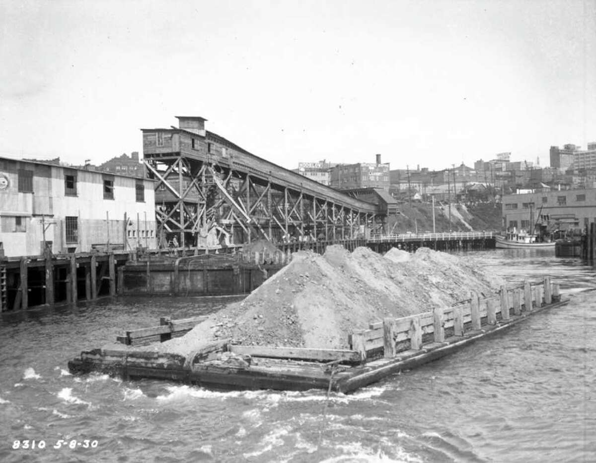 The Denny Regrade: It took a lot to shape Seattle's topography -- like the Denny Regrade, which involved making Denny Hill closer to the (lower) height we know today. Pictured: Dumping Denny Hill into Elliott Bay, May 8, 1930.