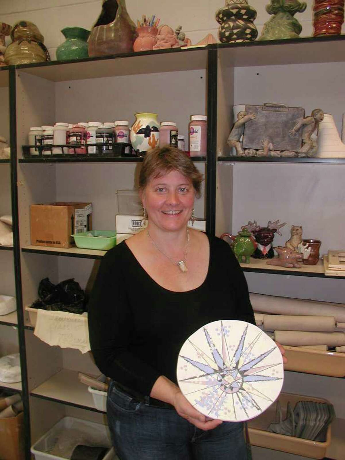 Lisa Floryshak-Windman, ceramics teacher at New Canaan High School, shows the pre-finished plate she painted that will be glazed, fired and finished into a cakeplate to be auctioned at the 10th anniversary Galaxy of STARS Gala on Nov. 12 at Woodway Country Club.