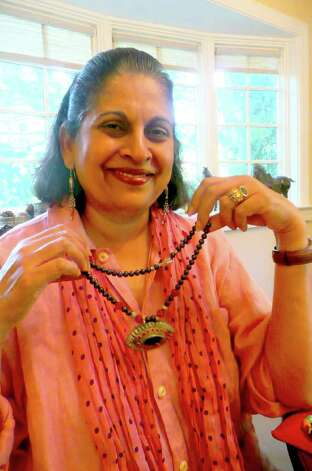 Chitra Ramcharandas has been making jewelry since her teenaged years in India, collecting the colorful beads and pendants she uses while on her many travels. Photo: Anne W. Semmes