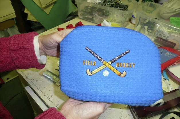 Hillary Brooke has turned the cosmetic bag into a desirable personalized item - here featuring a favorite sport. Photo: Anne W. Semmes