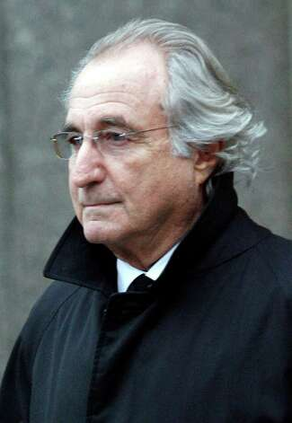 "In this Wednesday, Jan. 14, 2009 file photo, Bernard L. Madoff, the accused mastermind of a $50 billion Ponzi scheme, leaves Federal Court in New York. A book by Stephanie Madoff Mack, Madoff's daughter-in-law, ""The End of Normal:  A Wife's Anguish, A Widow's New Life"" goes on sale Thursday, Oct. 20, 2011.  (AP Photo/Stuart Ramson, file) Photo: Stuart Ramson, Associated Press / AP2009"