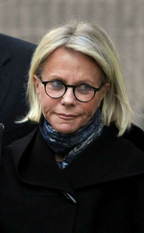 In this April 6, 2009 file photo, Ruth Madoff is escorted by private security as she leaves the Metropolitan Correctional Center after visiting her husband, disgraced financier Bernard Madoff,  in New York.  (AP Photo/Mary Altaffer) Photo: Mary Altaffer, Associated Press / AP2009