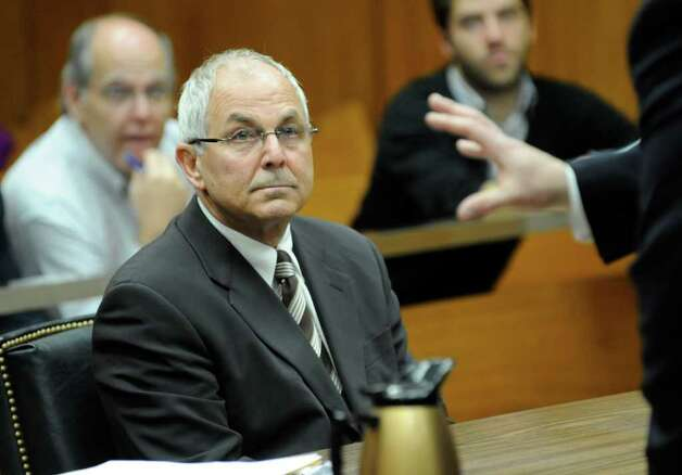 FILE - In this April 3 2009 file photo, Peter Madoff, brother of Bernard Madoff, attends his court hearing before judge Stephen Bucaria at Mineola State Supreme Court, in Mineola, N.Y. Nearly three years into the probe into Bernard Madoff's epic fraud, his brother, son and niece have avoided criminal charges, raising the possibility that they could get off entirely. (AP Photo/Louis Lanzano, Pool, File) Photo: Louis Lanzano, Associated Press / AP2009
