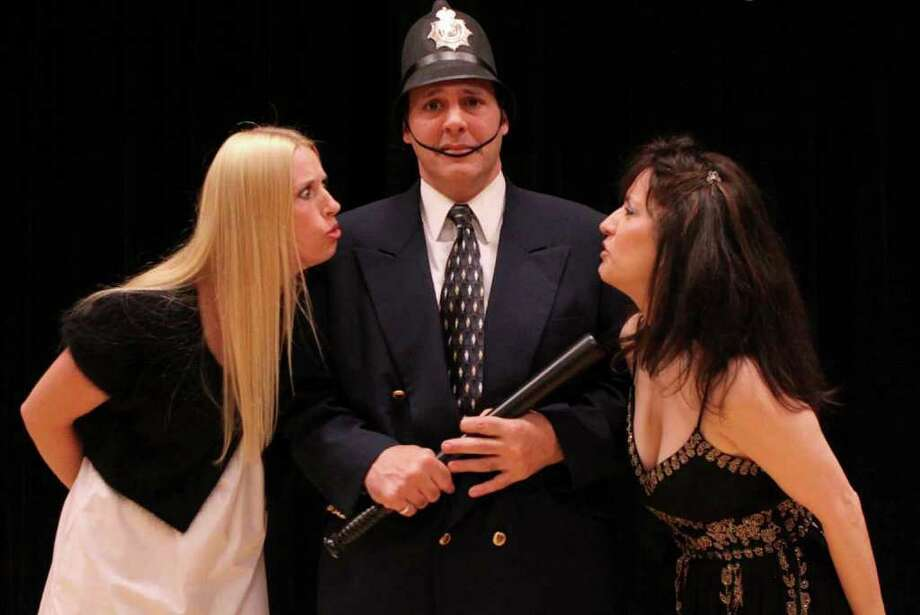 Tracy James of Newtown, Jimmy Santora of Greenwich and Deborah Burke of Stamford rehearse a scene from 'The Case of the Curious Condiment,' which will have its first full staging at the Darien Arts Center beginning Friday, Nov. 4. Contributed photo/Deb Failla Photo: Contributed Photo / Stamford Advocate Contributed