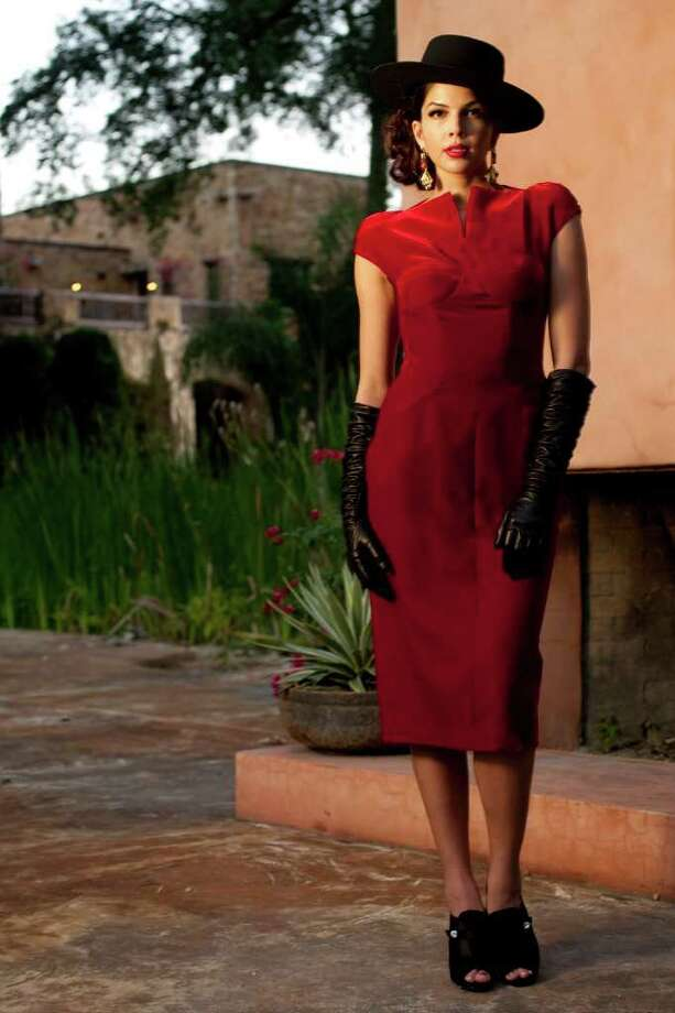 RED HOT: Julia Etherington of the Neal Hamil Agency wears a Tom Ford dress, Neiman Marcus; Pedro Garcia shoes and Lee Angel earrings, Joseph. Laurel gloves, Elizabeth Anthony-Esther Wolf. Photo: Nick De La Torre / © 2011  Houston Chronicle