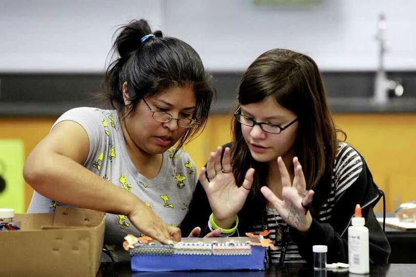 Anika Garza, 11, makes an altar with her mother, Laura Garza, for Wednesday's Dia de los Muertos cel