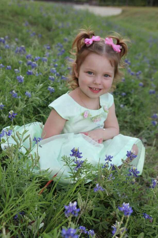 FAMILY PHOTO TRAGEDY: Four-year-old Rebecca Woodruff died after an accident Oct. 21 in her Kingwood home's driveway.