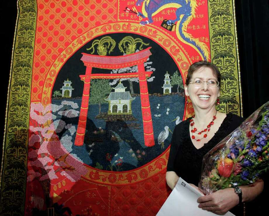 MELISSA PHILLIP: CHRONICLE DRAGON AND FISHERMAN: Sue McCarty says her design for the best of show quilt, Harmony Within, features Asian motifs. Her quilt and the other prize winners can be seen at the George R. Brown Convention Center. Photo: Melissa Phillip / © 2011 Houston Chronicle