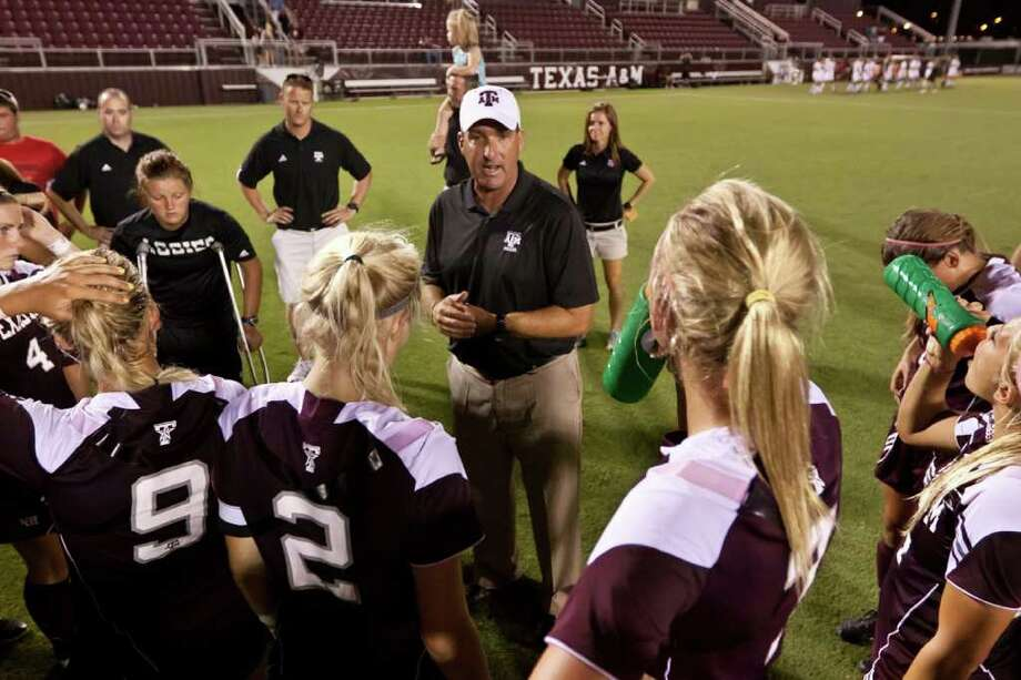The Big 12's most successful soccer program, coached by G. Guerrieri (center), takes its final swing against the league today when the No. 2-seeded Aggies take on No. 7 seed Kansas at Blossom. Photo: Courtesy Photo / Texas A&M Athletics