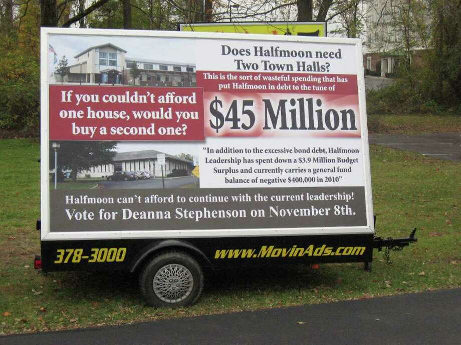 Halfmoon's building and development director warned a local business owner last weekend that the campaign sign affixed to this trailer is a violation of town code. The business owner and his customer, Democrat Deanna Stephenson, are accusing the town of politically motivated selective enforcement. (Times Union photo)