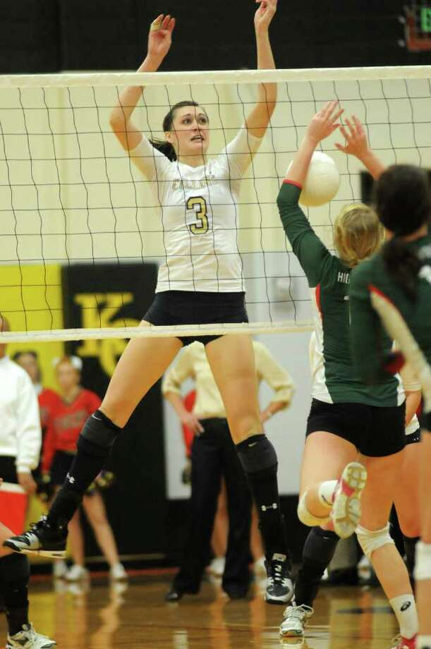 Klein Collins senior middle blocker Molly McCage (3) puts down a kill against The Woodlands senior setter Kate DeLess. Photo: Jerry Baker, For The Chronicle