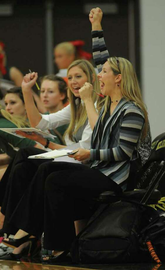 The Woodlands Head Coach Leslie Madison, right, and Asst. Coach Megan McDougald celebrate a Lady Highlander point against Klein Collins. Photo: Jerry Baker, For The Chronicle