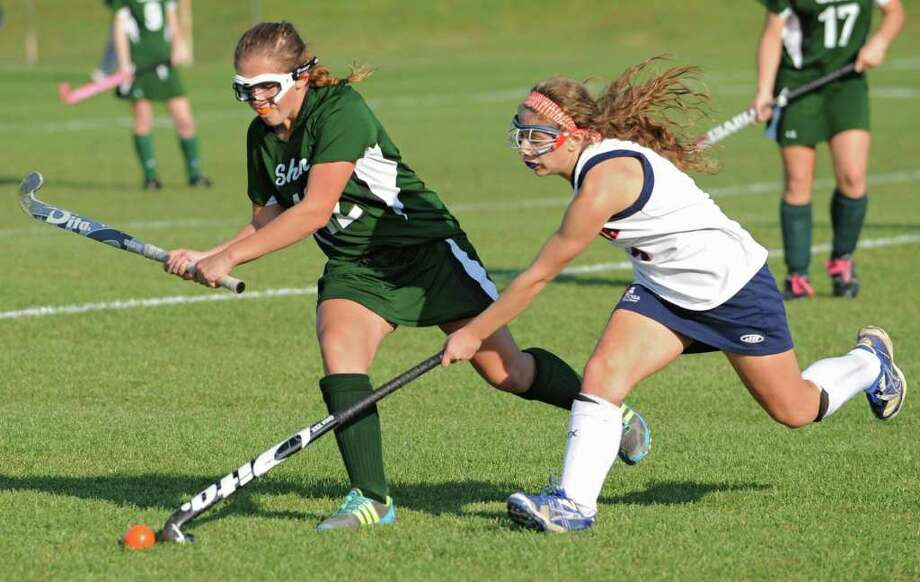 From left, Anna Bottino of Shenendehowa battles for the ball with Megan Leanza of Saratoga during a Class A semifinal field hockey game in Saratoga Springs, N.Y. Tuesday, Nov. 1, 2011.  (Lori Van Buren / Times Union) Photo: Lori Van Buren