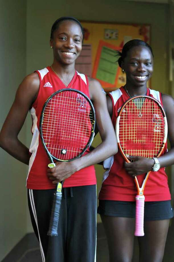 Emma Willard's Keishora Armstrong, left, and Chassidy King, right, after winning their doubles match during the Section II girls tennis finals at Sportime on Tuesday Nov. 1, 2011 in Rotterdam, NY.  (Philip Kamrass / Times Union ) Photo: Philip Kamrass / 00015212A