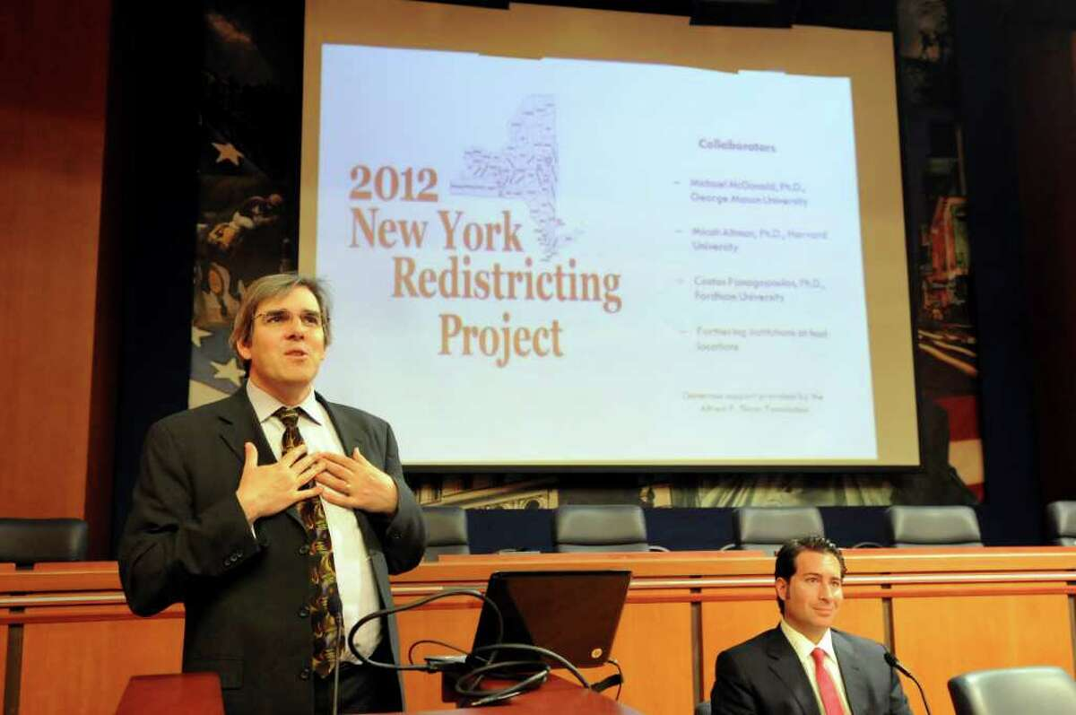 Michael P. McDonald, associate professor of Government and Politics at George Mason University, left, talks about the 2012 New York Redistricting Project on Tuesday, Nov. 1, 2011, at the Legislative Office Building in Albany, N.Y. At right is Costas Panagopoulos, associate professor of Political Science at Fordham University. (Cindy Schultz / Times Union)