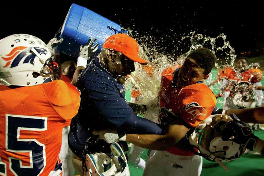 AT LAST: Coach Allen Aldridge soaks up Bush's first taste of the playoffs after being on the staff for all 10 of its varsity seasons. Photo: Smiley N. Pool / © 2011  Houston Chronicle