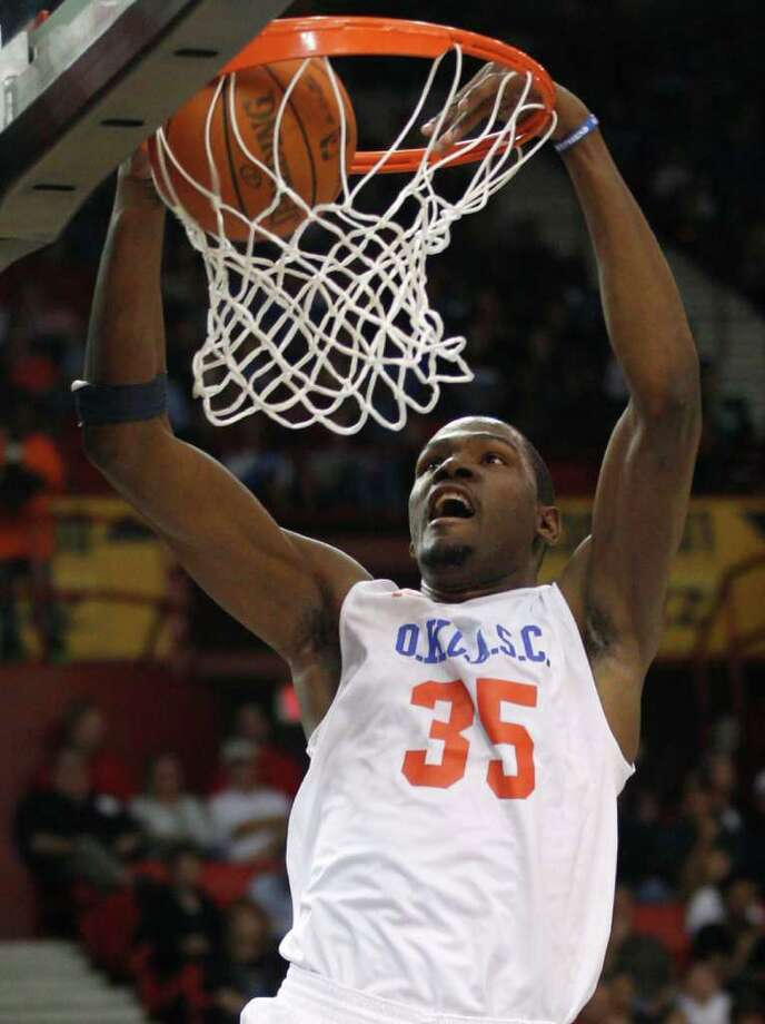 Kevin Durant dunks during the Basketball Invitational charity game in Oklahoma City on Oct. 23. (AP Photo/Sue Ogrocki) Photo: Sue Ogrocki / AP
