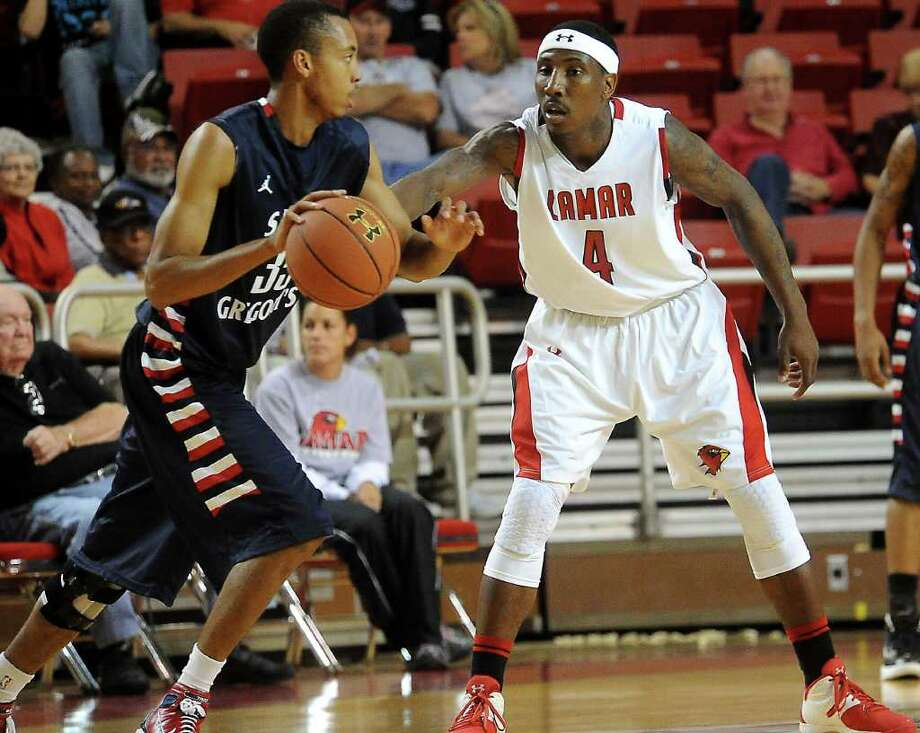 Lamar's Devon Lamb guards as St. Gregory's Brandon Jackson controls the ball at the Montagne Center at Lamar in Beaumont, Tuesday, November 1, 2011. Tammy McKinley/The Enterprise Photo: TAMMY MCKINLEY