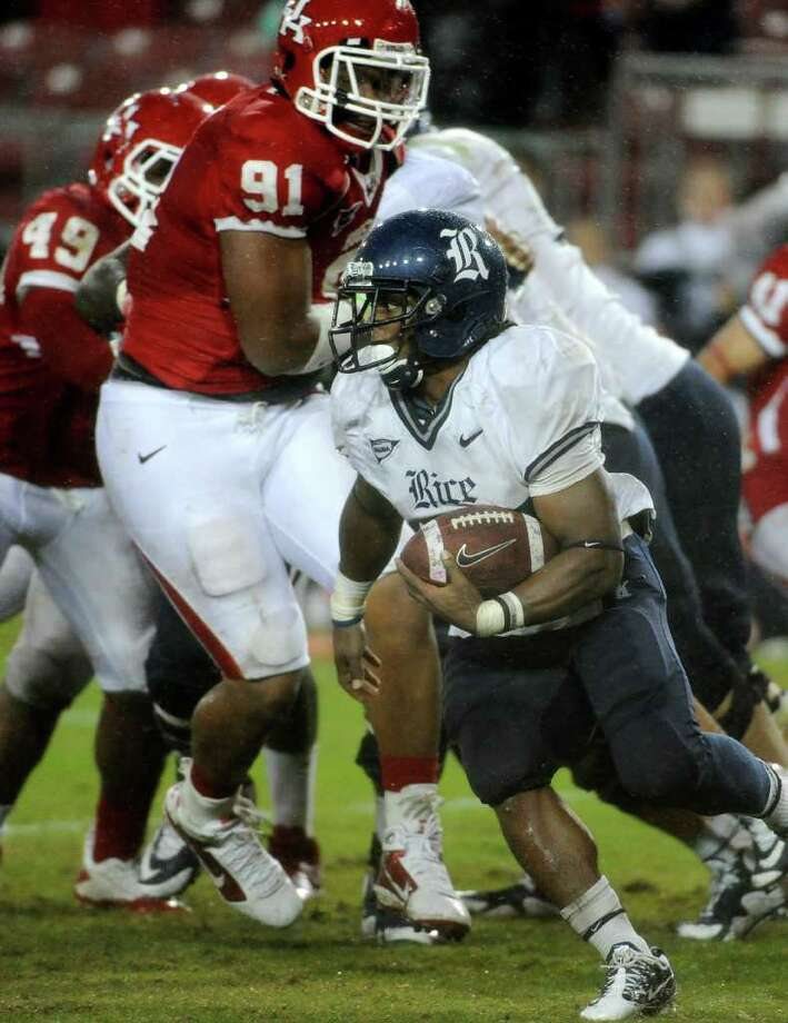 NICE NUMBERS: Rice's Tyler Smith came up big against Houston with 170 yards rushing, highlighted by a 97-yard run. Photo: Pat Sullivan / AP