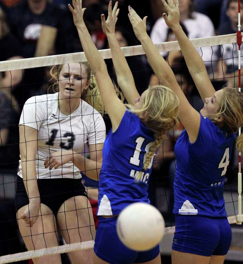 Rebekah Rightnour of Steele spikes a kill past MacArthur defenders Claire Scharper (10) and Taylor Bazajou at Steele Gym on Tuesday, Nov. 1, 2011. Photo: Tom Reel / Treel@express-news.net / © 2011 San Antonio Express-News