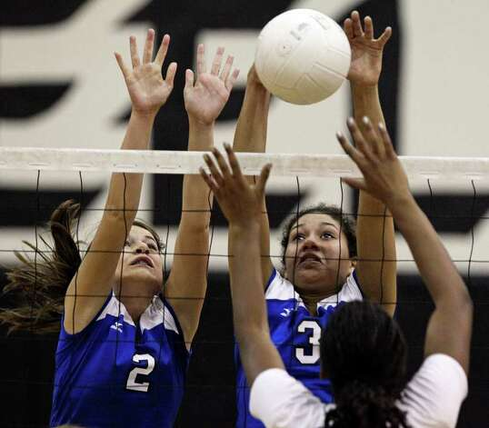MacArthur players Dana Moore (2) and Blake Johnson go up to block a shot from Steele at Steele Gym on Tuesday, Nov. 1, 2011. Photo: Tom Reel / Treel@express-news.net / © 2011 San Antonio Express-News