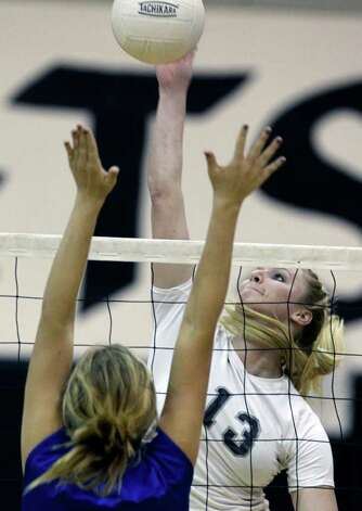 Steele's Rebekah Rightnour goes high to tip a shot against MacArthur at Steele Gym on Tuesday, Nov. 1, 2011. Photo: Tom Reel / Treel@express-news.net / © 2011 San Antonio Express-News