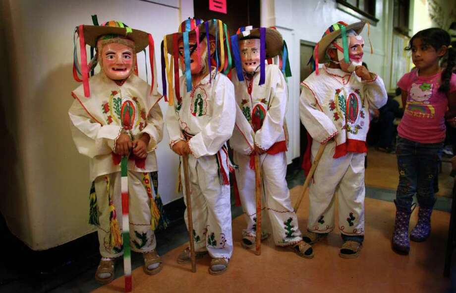 """Members of """"Los Nietos de Charro"""" dance group, from left, Marcos Sebastian, 7, Carlos Gomez, 7 Richard Flores, 8, and Luis Luna, 7, wait to take the stage during a Día de los Muertos (Day of the Dead) celebration at El Centro de la Raza on Tuesday, November 1, 2011. The Mexican holiday honors the deceased with gifts placed at altars and visits to graves. Photo: JOSHUA TRUJILLO / SEATTLEPI.COM"""