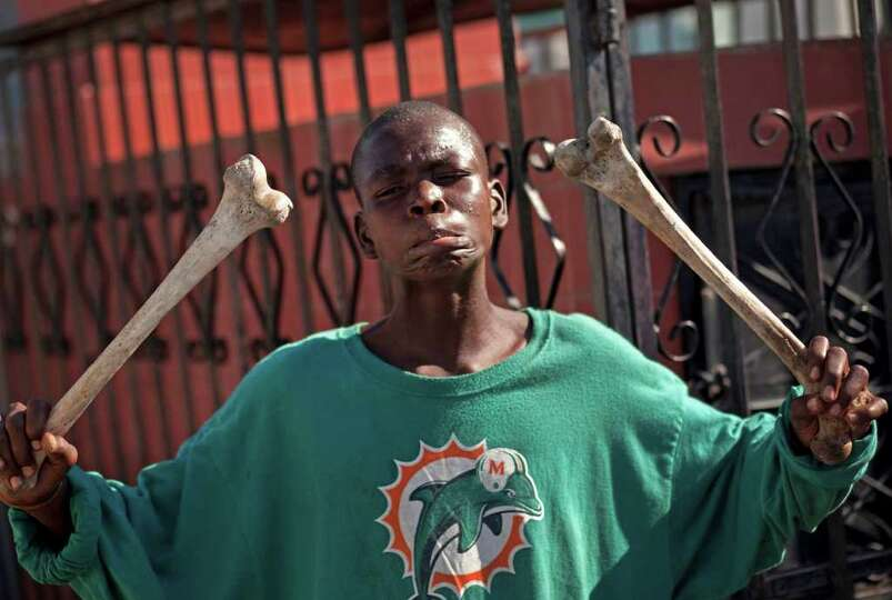 An intoxicated man jokes while holding two human femurs he took out of an open grave at the national