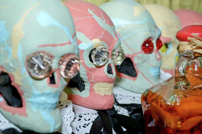 A row of decorative skulls sits on an alter setup at 201 Gallery for the Dia De Los Muertos holiday,