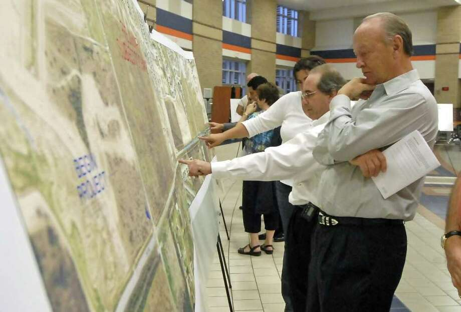 CHECKING IT OUT: Jim Carpenter, who has property on part of the proposed right of way for FM 1093/Westpark Tollway, attended the Oct. 27 Texas Department of Transportation open house on proposed roadway expansion. Photo: Tony Bullard / Credit: for the Chronicle