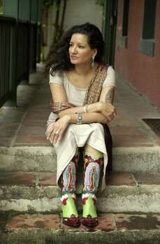 **  ADVANCE FOR WEDNESDAY, JAN. 14 AND THEREAFTER -- FILE ** In this Sept. 16, 2002 file photo, author Sandra Cisneros sits for a portrait in San Antonio. Photo: Eric Gay, AP / AP