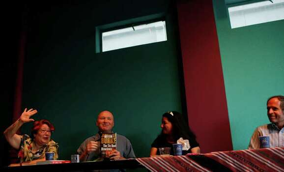 "METRO - Norma Alarcon, from left, admits to reading books by Rod Davis' ""guilty pleasure"" author James Lee Burke as Davis talks about the book while Sandra Cisneros and Steven G. Kellman look on during the National Book Critics Circle Good Reads event at Gemini Ink in San Antonio on Friday, May 30, 2008. LISA KRANTZ/lkrantz@express-news.net Photo: Lisa Krantz, SAN ANTONIO EXPRESS-NEWS / SAN ANTONIO EXPRESS-NEWS"