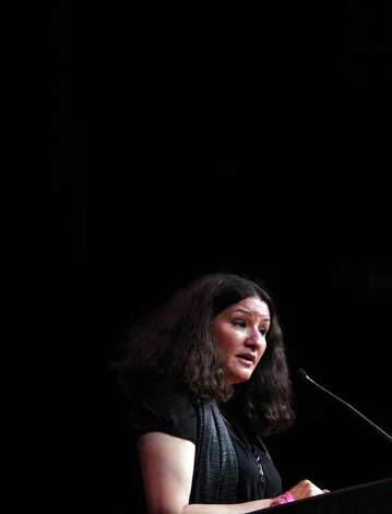 "METRO:  Sandra Cisneros speaks with students at Our Lady of the Lake's Literary Festival ""Just Words/Palabras de Justicia"" on Friday April 4, 2008 at Thiry Auditorium.  Helen L. Montoya/Staff Photo: HELEN L. MONTOYA, SAN ANTONIO EXPRESS-NEWS / SAN ANTONIO EXPRESS-NEWS"