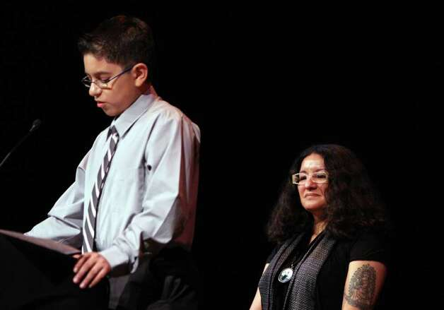 "METRO:  Sandra Cisneros listens as Rodrigo Cervantes gives a literary presentation prior to Cisneros speaking with students at Our Lady of the Lake's Literary Festival ""Just Words/Palabras de Justicia"" on Friday April 4, 2008 at Thiry Auditorium.  Helen L. Montoya/Staff Photo: HELEN L. MONTOYA, SAN ANTONIO EXPRESS-NEWS / SAN ANTONIO EXPRESS-NEWS"